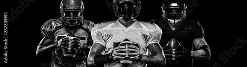 Photo American football player, sportsman in helmet on dark background