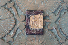 Buddha Plaque On Ornately Carved Wood. Still Life Photography.