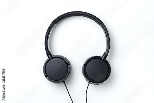 fototapeta na drzwi i meble Black headphones isolated on white background. Flat lay top view copy space. Music concept. Minimal style