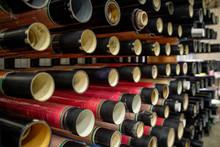 Several Rows Of Pipe-like Bobbins Prepared For New Batch Of Polyethylene Film