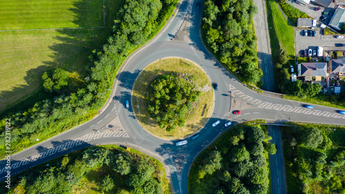 Fotografie, Obraz  Aerial long exposure of traffic on a roundabout in a small town