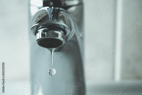 Fotografie, Obraz  water drop dripping from the tap and water shortage