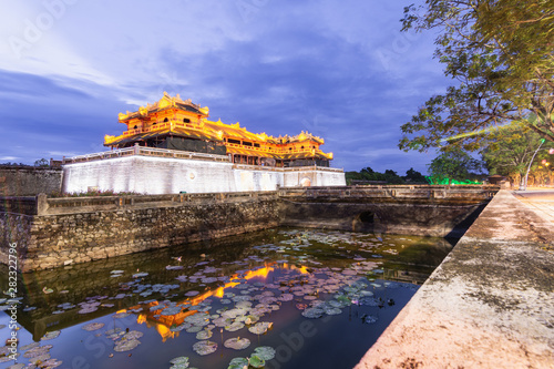 Obraz na plátně  Main gate to the purple forbidden imperial city at sunset in Hue, Vietnam