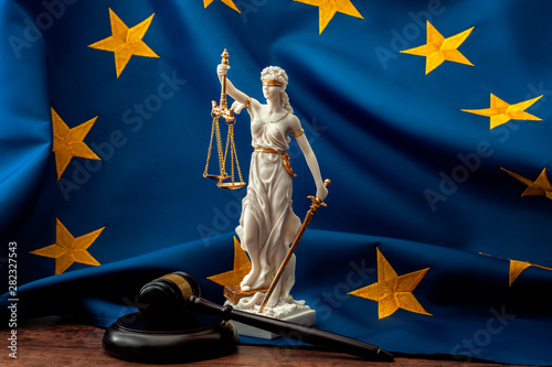 Foto auf Leinwand Texturen European union court of justice or ECJ, legal system in Europe and the legislature branch of government concept with a gavel, a statue of Themis the lady of justice and the EU flag