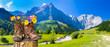 canvas print picture - Wanderschuhe mit Blumen in schöner bayerischer Landschaft
