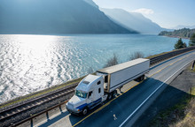 Big Rig Semi Truck Transporting Cargo In Refrigerator Semi Truck Running On The Road Along Columbia River