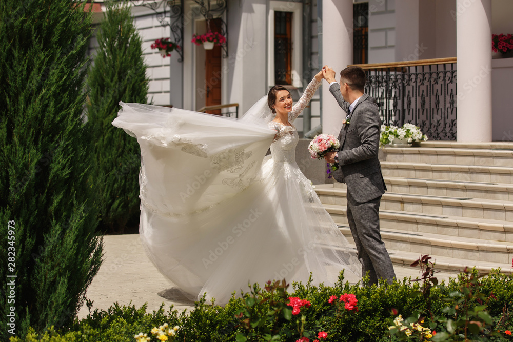 Fototapeta Wedding dance. Bride and groom dancing at wedding day. Happy couple in love