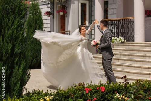 Fototapeta Wedding dance. Bride and groom dancing at wedding day. Happy couple in love obraz