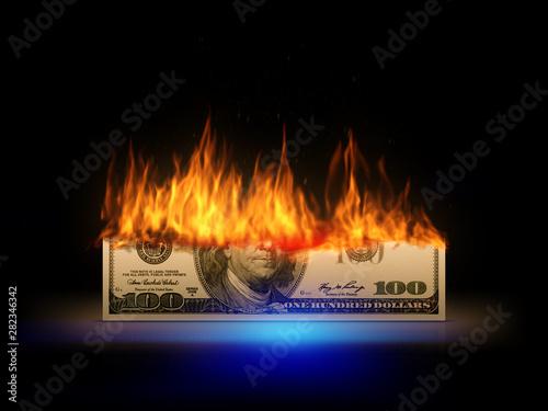 Fotografiet  a burning 100 dollar bill