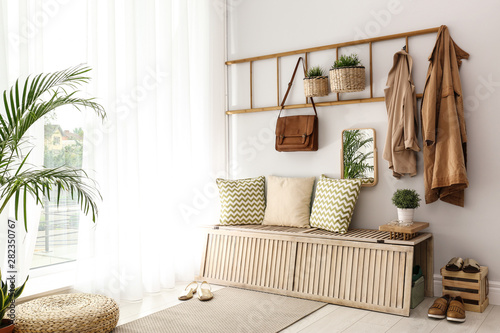 Fotografía  Cozy hallway interior with new stylish furniture