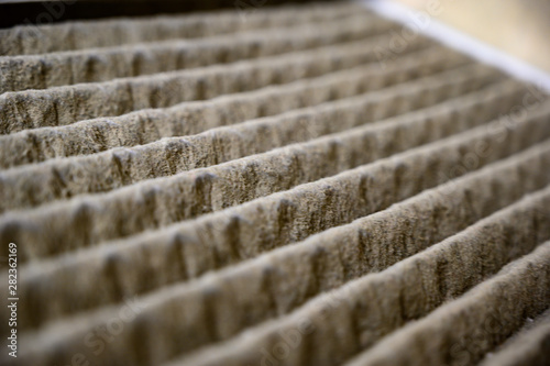 Fotografía  Dirty and dusty used house air filter close-up