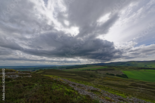 Looking West over the Strathmore Valley from the White Caterthun near Brechin and Edzell, with heavy clouds on an early Spring morning Canvas Print