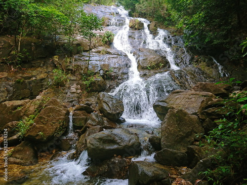 Fototapeten Forest river National park Waterfall in to the Thailand jungle