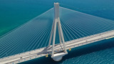 Aerial drone photo of world famous cable suspension bridge of Rio - Antirio Harilaos Trikoupis, crossing Corinthian Gulf, mainland Greece to Peloponnese, Patras