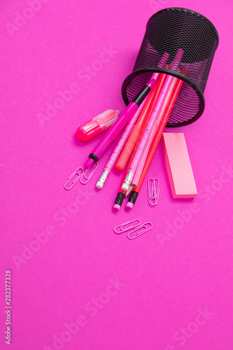 Fényképezés Group of pink color stationery products are scattered from pencil bin from top t