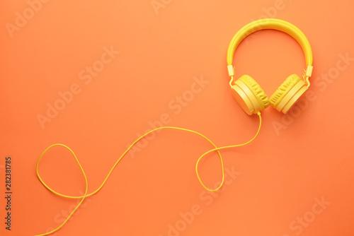 Fotografia Modern headphones on color background