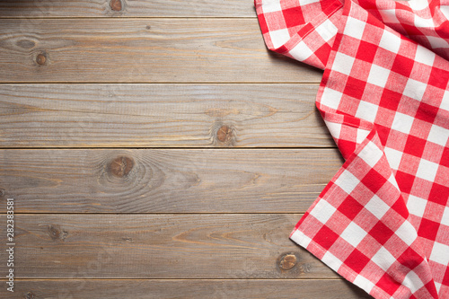 Obraz na plátně  cloth napkin on at rustic wooden table background