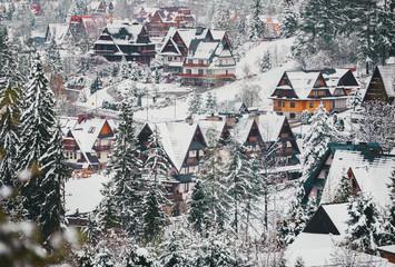 Small town village near Zakopane in the winter foggy morning in Tatra mountains.