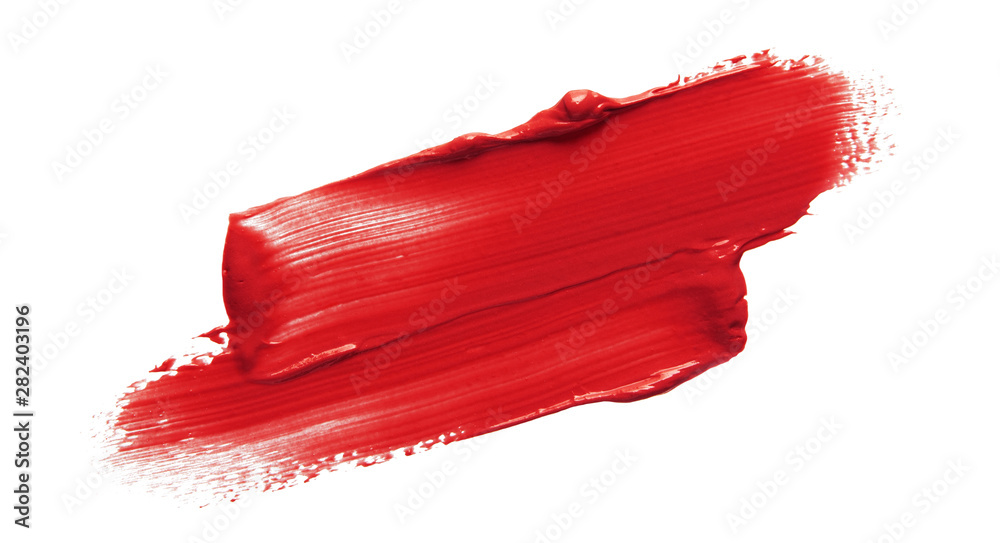Fototapeta Lipstick smear smudge swatch isolated on white background. Cream makeup texture. Bright red color cosmetic product brush stroke swipe sample