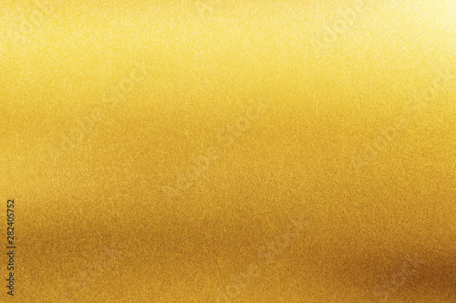 Photo Gold texture background. Retro golden shiny wall surface.