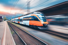 High Speed Orange Train In Mot...