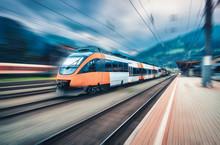 High Speed Orange Train In Mot...