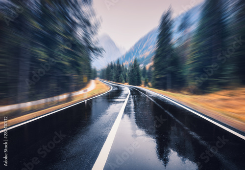 Road in the autumn forest in rain with motion blur effect Canvas-taulu