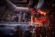 Worker cuts metal grinder. Sparks fly