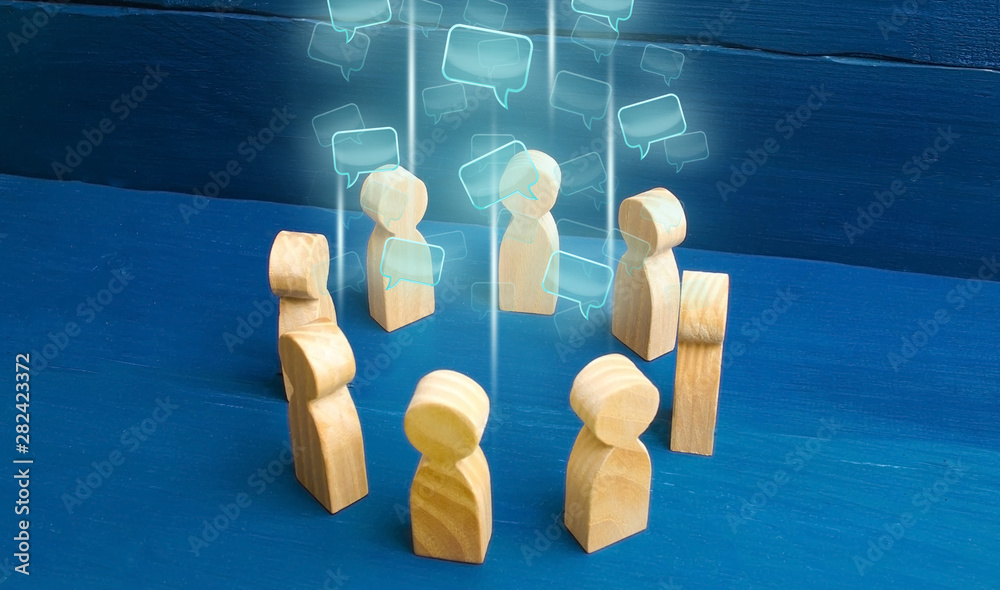 Fototapeta Speech clouds in the center of a people circle. Discussion processes in a team or community. Share opinion, diplomacy. Collaboration and cooperation, participation in a meeting. Business negotiations.