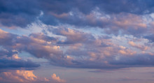Beautiful Sky At Sunset: Soft Pink, Beige And Dark Blue Clouds