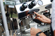 Barista making coffee using professional espresso machine