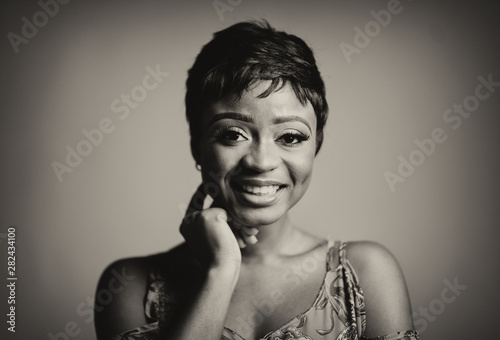 Fototapety, obrazy: Portrait of a beautiful young African woman over yellow background. Studio picture