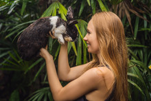 Woman Holding A Rabbit. Cosmetics Test On Rabbit Animal. Cruelty Free And Stop Animal Abuse Concept