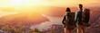 Leinwandbild Motiv Happy Couple Watching the Sunset in the Mountains