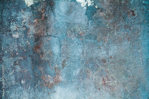 Old blue distressed wall background or texture