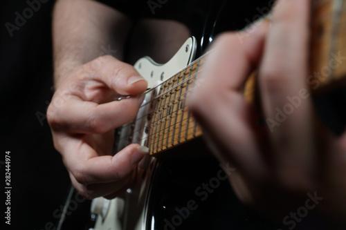 Guitar player on black background Wallpaper Mural