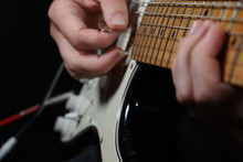 Guitar Player On Black Background
