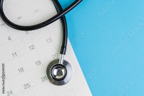 Photo Health care and medical exam schedule calendar, reminder or appointment concept,
