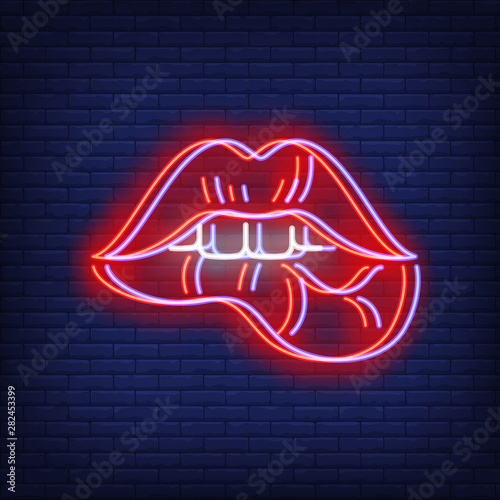 Woman lips biting neon sign with chromatic aberration effect Canvas Print