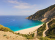Fantastic turquoise sea and white beach to which the road descends from the picturesque mountains. Myrtos beach, Kefalonia island, Greece