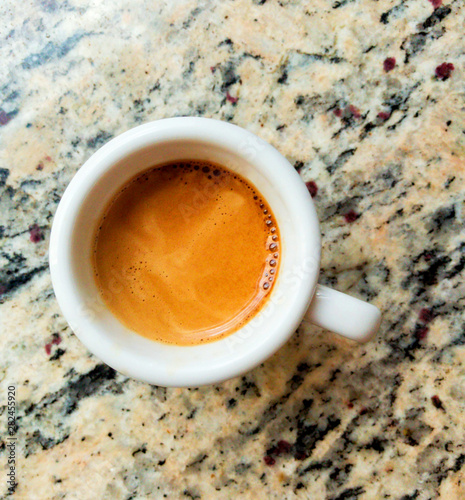 Photo Stands Coffee bar Black coffee in a coffee cup top view isolated on a marble table