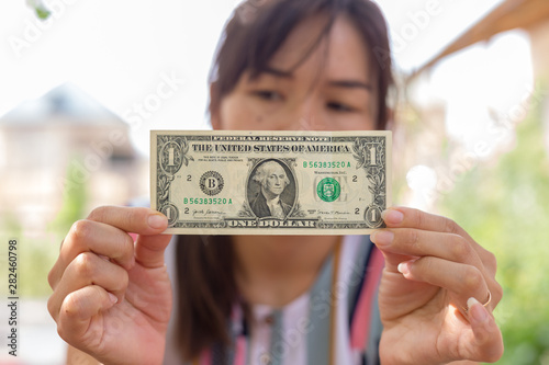 Valokuva  in the hands of a girl a dollar bill