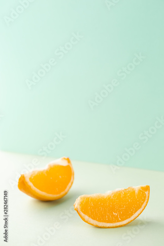 Minimalist slices of orange on blue background