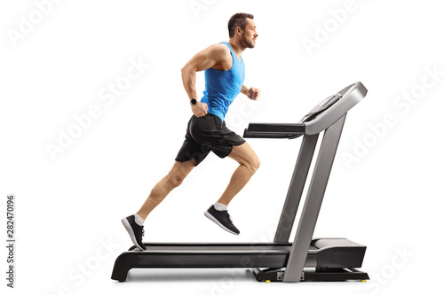 Fotografia Young man in sportswear running on a professional treadmill