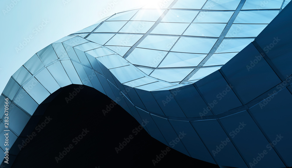 Fototapeta Modern architecture business building abstract curve line details steel facade background .