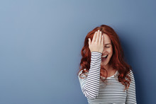Laughing Happy Young Woman Covering An Eye