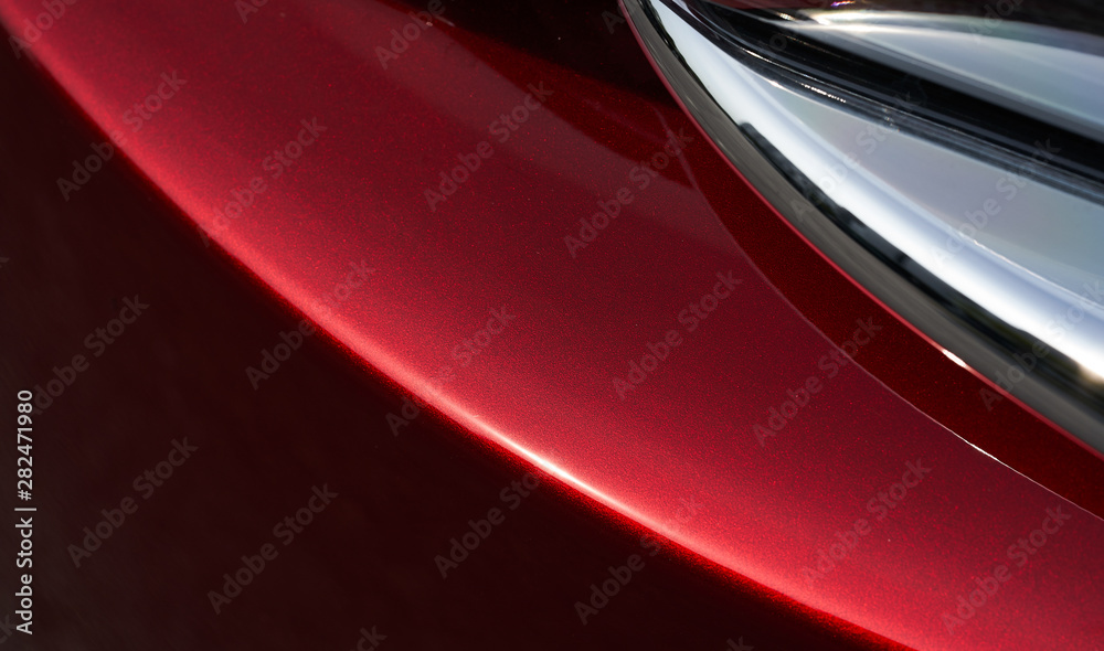 Fototapeta Close up detail of red metallic paint coating car body