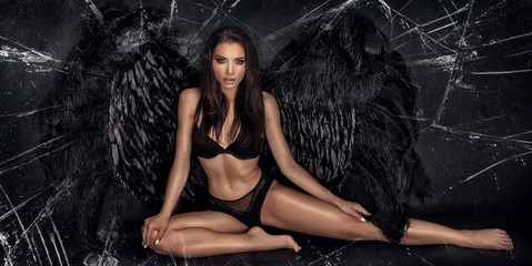 FototapetaSexy beautiful woman in lingerie and angel black wings.