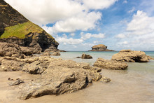 The Bay In The Small Town Of Trevaunance Cove Near St Agnes In Cornwall On The Atlantic Coast. View Of The Sea And Rocks In The Sunshine And Blue Sky.