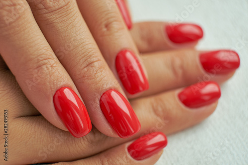 Fotografie, Obraz perfect red manicure. nail and hand care in the salon